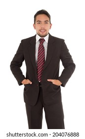 handsome latin man wearing a suit and red tie isolated over white