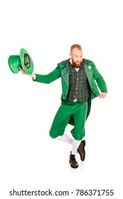 handsome leprechaun in green costume holding hat, isolated on white