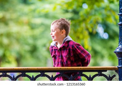 A handsome little boy with ADHD, Autism, Asperger Syndrome plays at the park smiling, laughing and having fun, energetic