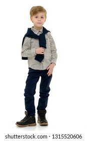 Handsome little boy in full growth on a white background. The concept of advertising, happy childhood. Isolated.