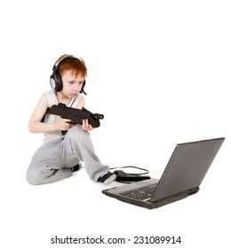 handsome little boy in headphones playing with the pistol