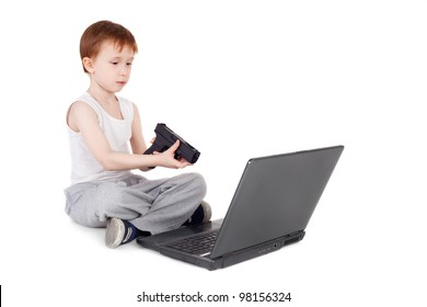 handsome little boy playing computer game with the pistol