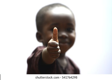 Handsome Little Boy Showing Us Thumbs Up