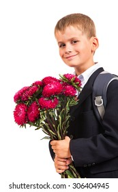 Handsome little schoolboy is holding flowers isolated on white background. Back to school