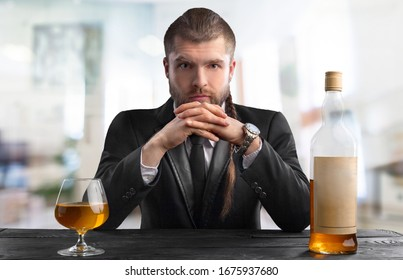 Handsome male barman with alcohol drink