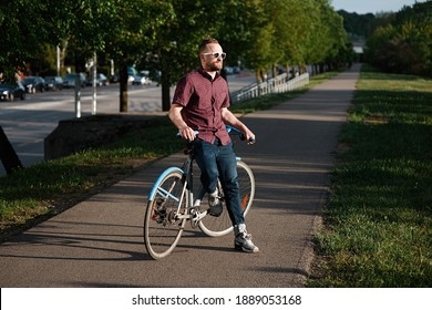 A handsome male with bicycle and backpack
