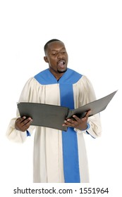 Handsome male church choir member in choir robe holding a music folder and singing.  Isolated on white.