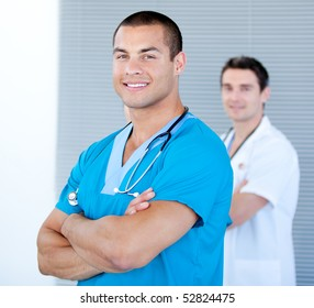 Handsome male doctor looking at the camera in the hospital