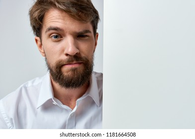 handsome male emotion flirting with the viewer white sheet of paper   poster , mock-up