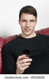 Handsome male face with mobile looking at the camera