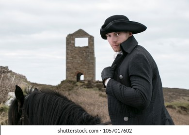 Handsome Male Horse Rider Regency 18th Century Poldark Costume with tin mine in background