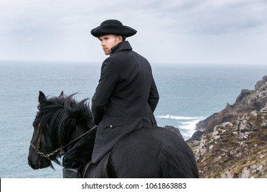 Handsome Male Horse Rider Regency 18th Century Poldark Costume with tin mine ruins and Atlantic ocean in background