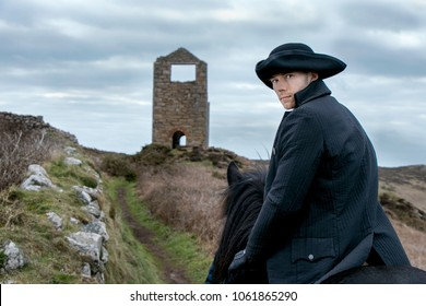 Handsome Male Horse Rider Regency 18th Century Poldark Costume with tin mine ruins and countryside in background