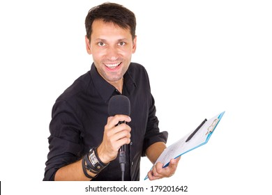 handsome male journalist reporting news on microphone with notes in hand