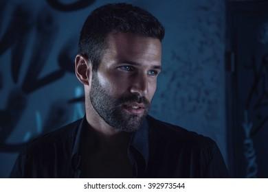 Handsome male model in dark alley