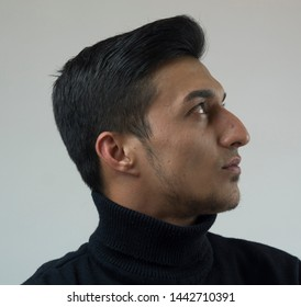Handsome male model standing on white background