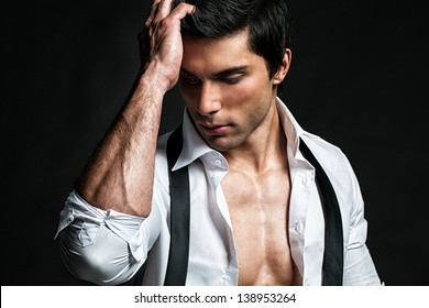 Handsome male model touching his head.