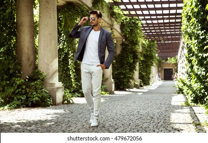 Handsome male model wear fashionable clothes and aviator sunglasses