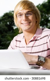 handsome male student with laptop