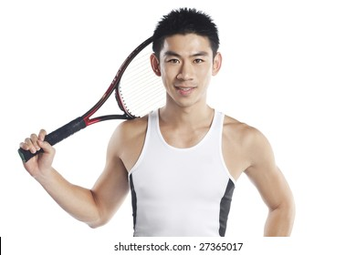 Handsome male tennis player isolated in white
