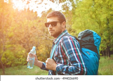 Handsome male traveler resting in nature