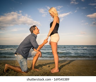 Handsome man asking his woman to marry