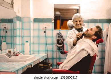 Handsome man at a barber shop.
