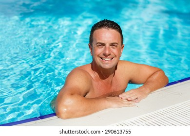 7e7b6af08d Handsome man at beach pool, sexy male model fit man posing in swimming pool,