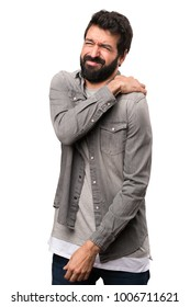 Handsome man with beard with shoulder pain on white background