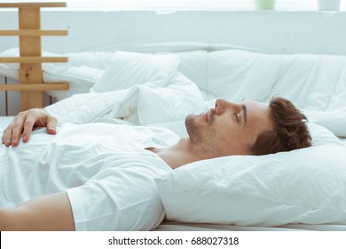 Handsome man in bed sleep relax at home morning in bedroom alone.