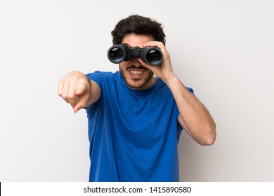 Handsome man with black binoculars