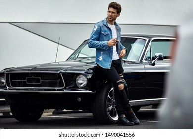 Handsome man with black classic car wear smart casual