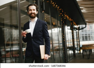 Handsome man in a black suit. Businessman working in a office