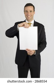 Handsome man in black suit holding up paper