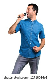 Handsome man with blue shirt singing with microphone