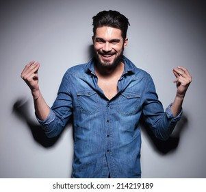 Handsome man in blue shirt smilling and moving his hands