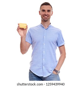 Handsome man in blue shirt with white card.
