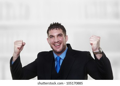 handsome man with both arm up in the air looking very happy about something