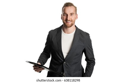 Handsome man in business casual clothing standing holding a clipboard, in front of a white background.
