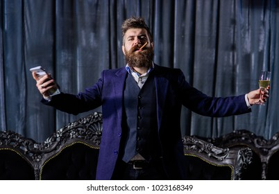 Handsome Man Businessman in suit. Boss drink alcohol in the glass and enjoys the success. The concept of a successful business