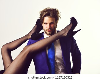 handsome man or businessman in suit and female sexy legs in fashionable shoes and tights isolated on white background, love and relations, power, boss, office romance, sexual services, couple in love