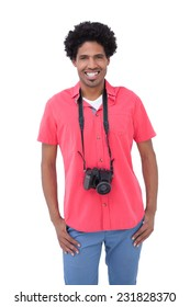 Handsome man with camera around his neck on white background