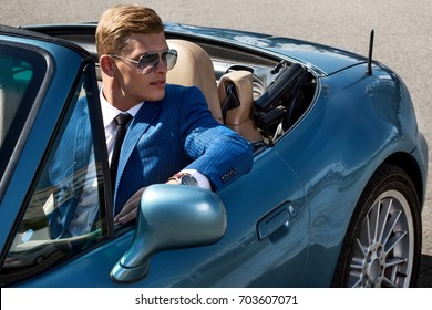 Handsome man in the car, businessman