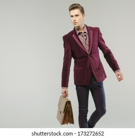 Handsome man carrying a handbag