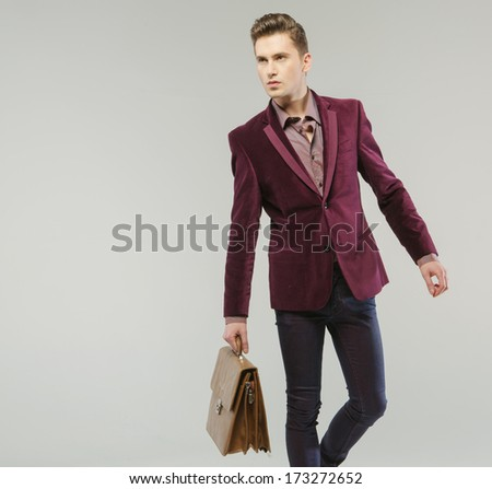 Handsome Man Carrying Handbag Stock Photo (Edit Now) 173272652 ... afb4905dbba7