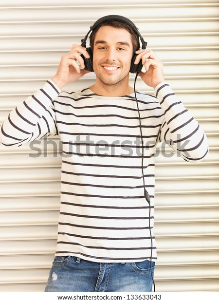 handsome man in casual clothes with headphones