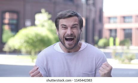 Handsome Man Celebrating Success  Gesture in Offcie
