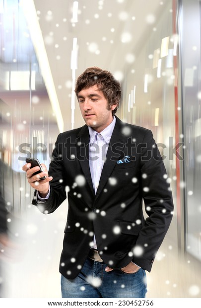 Handsome man with cell phone. Christmas and holidays concept