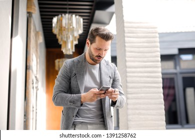 Handsome man checking his smartphone.