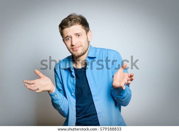 Handsome man choosing between two options